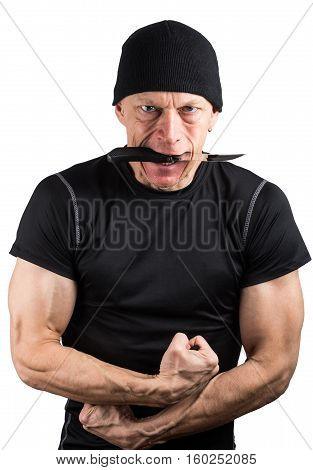 Angry Man With Knife In His Mouth And With His Fists