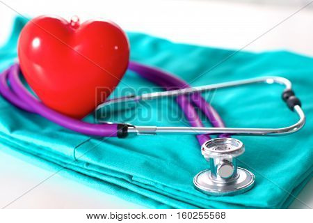 Stethoscope on a background of medical coat.