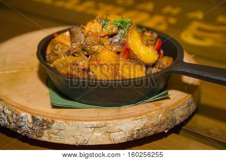 Fried Potatoes With Meat And Mushrooms.