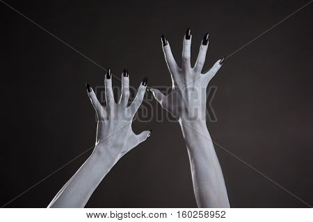 Demonic hands with black nails, Halloween body art