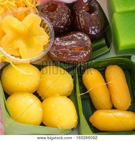 The group of Thai sweet dessert : Layer sweet cake (Kanom Chan), Egg yoke fudge ball (Thong Yot), Golden threads (Foi Thong), Golden flowers (Thong Yip), Golden jackfruit seeds (Medkanhoon).