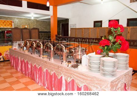 Catering wedding or hotel breakfast service with heater on metal buffet line event celebration