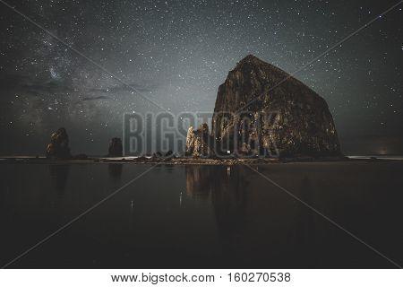 Milky Way behind Haystack Rock in Cannon Beach, Oregon.