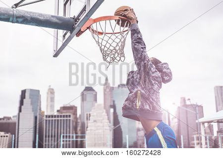 Huge slam dunk on a basketball court in New york