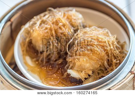 Chinese dim sum Sea Bass with vermicelli - Steamed Chinese groumet cuisine
