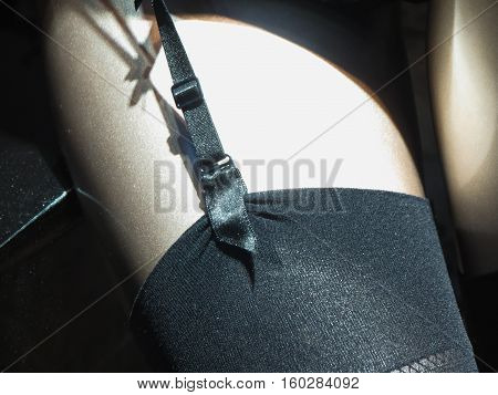 detail of a pair of black stockings with welt suspender belt suspender and clip