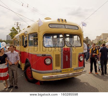 MOSCOW, RUSSIA - August 13, 2016: Citizens visiting the retro city bus of the 1950's ZIS 155. Festive occasion of the Moscow bus on the Frunze Embankment. August 13, 2016 in Moscow, Russia