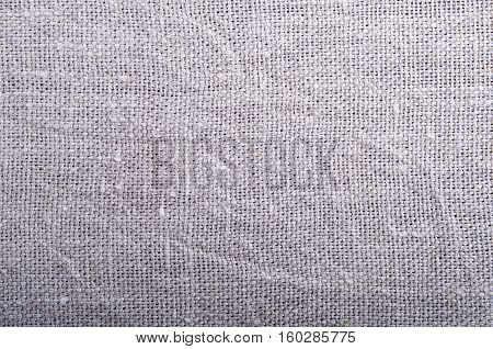 Close-up view on grey fabric background burlap