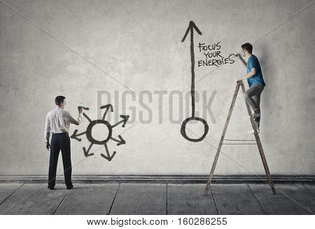 Two men drawing on the wall