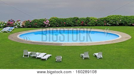 An Outdoor Oval Swimming Pool at a Coastal Resort.