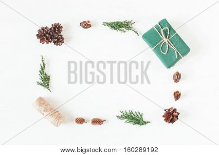 Christmas composition with pine cones cypress branches christmas gift. Top view flat lay