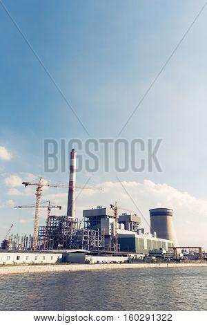 modern power plant near water