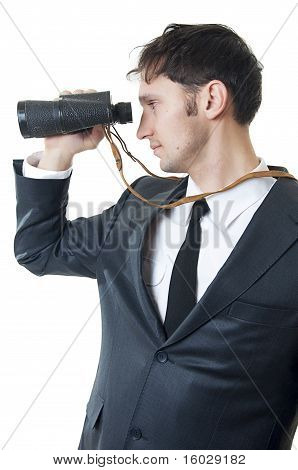 Young Business Man Looking Through Binoculars