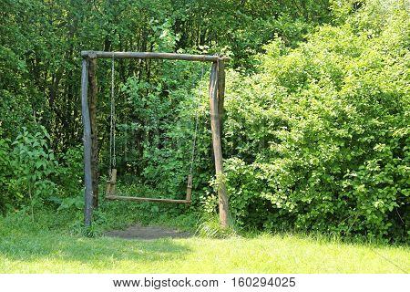 Old wooden swing outdoor