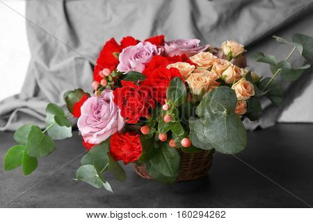 Beautiful roses bouquet on table
