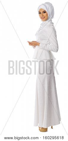 Young muslim woman on white