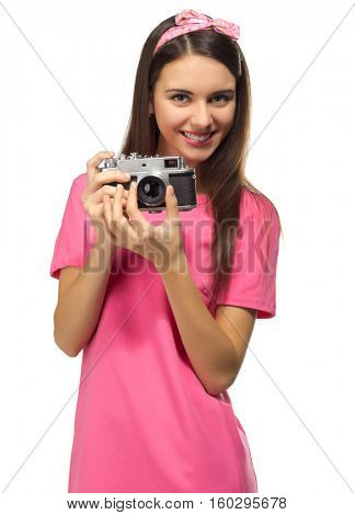 Young girl with camera isolated on white