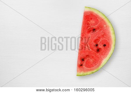 Watermelon slice on white table top view