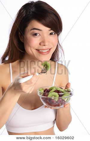 Girl eating healthy fruit salad