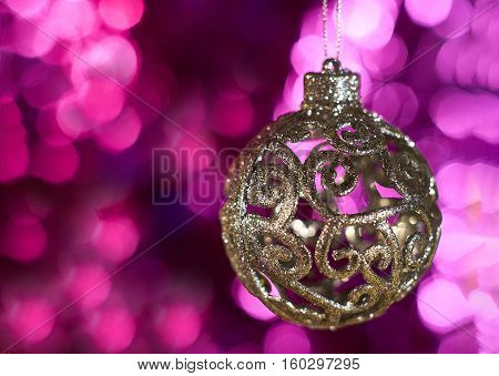 Christmas toy ball on a colored background with sparkles