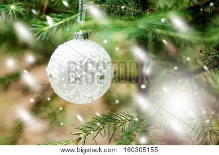 Christmas Ornaments including toys on Christmas tree.