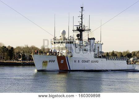 Cape Cod Canal Massachusetts USA - February 25 2007: USCGC Tahoma (908) a 270-foot medium endurance cutter transiting Cape Cod Canal