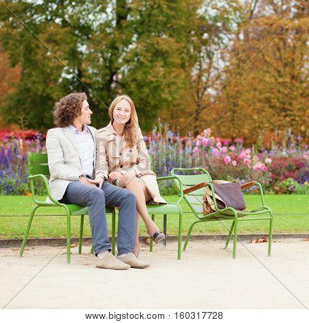 Happy Couple In The Tuileries Garden Of Paris