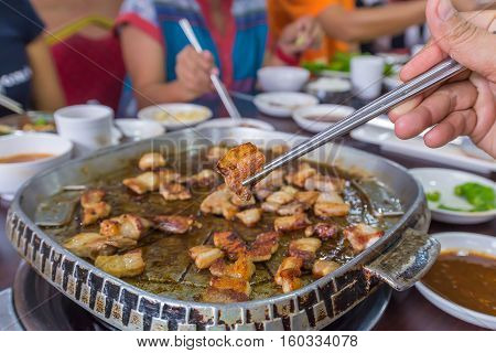 Delicious Grilled Pork Barbecue, Meat Are Being Cooked On Stove