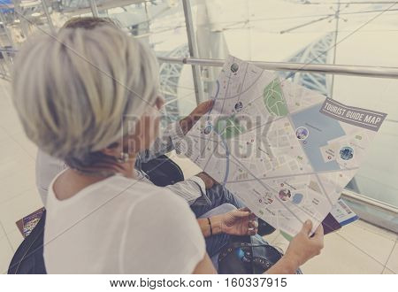 Senior couple traveling looking at a map