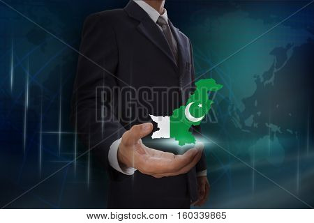 Businessman showing map of Pakistan on globe background