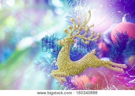 Christmas Tree Ornaments golden Reindeer Deer Hanging Decor Gift and blurry background