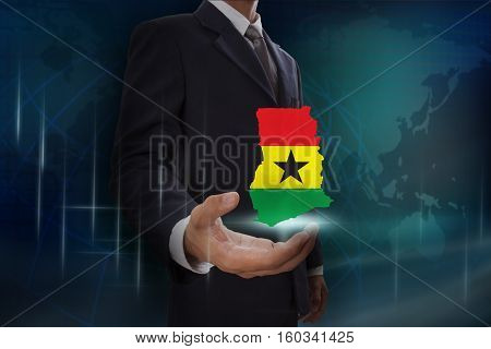 Businessman showing map of Ghana on globe background