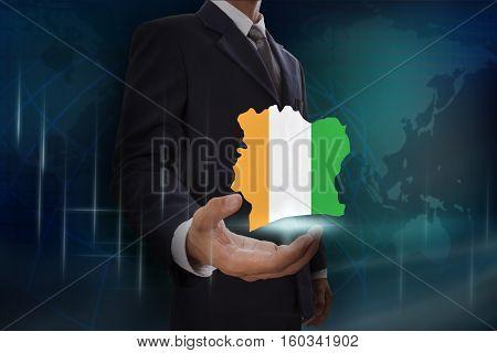 Businessman showing map of Ivory Coast on globe background