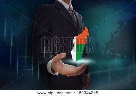 Businessman showing map of Madagascar on globe background