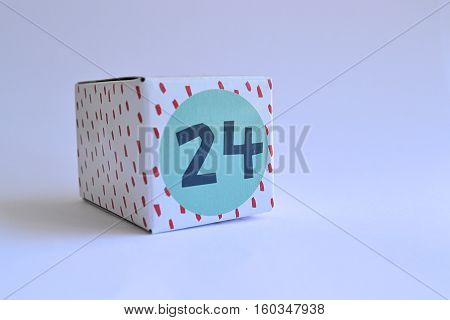 cardboard box cube with number twenty four 24 printed on it