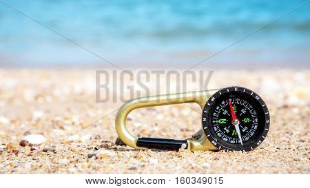 Compass In The Sand On The Beach