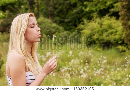 Young woman posing with flowers . Outdoor shot.
