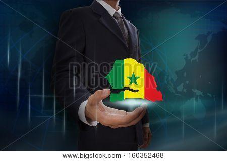 Businessman showing map of Senegal on globe background