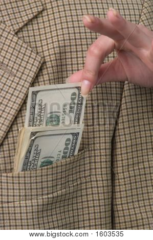 Money In A Pocket Of A Checkered Jacket