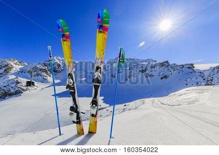 Ski winter season - mountains, cable car and ski equipments on ski run