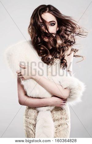 Beautiful Girl with Windy brown Hair Posing