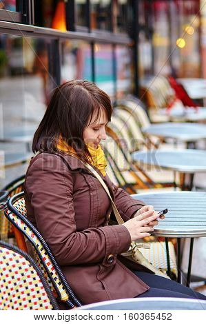 Young Tourist In Paris Sending Sms