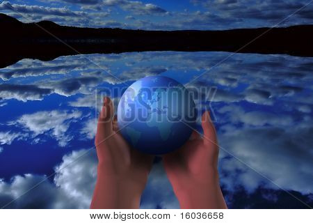 The earth cradled in hands over a reflective lake