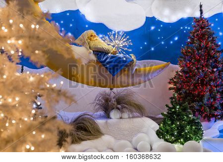 Abstract - gnome is sleeping on the moon in the forest close to Christmas tree - installation