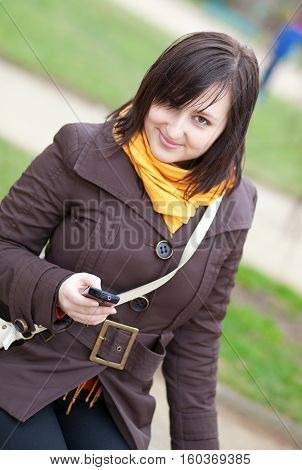 Beautiful Young Girl Sending Sms Using Her Cell Phone