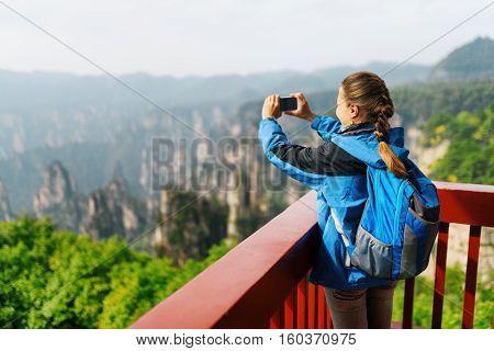 Female Tourist Taking Photo Of Zhangjiajie Mountains, China
