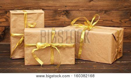 Three presents on wooden floor