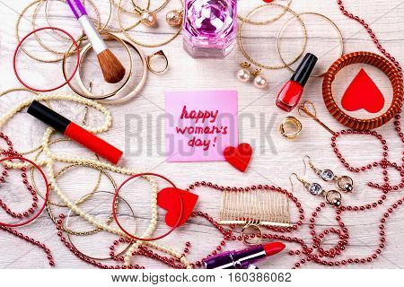 Happy Women's Day pink card. Jewelry items and cosmetics. Complete your style. Chic in every detail.