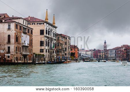 Palaces And Rialto Bridge On Grand Canal In Rain