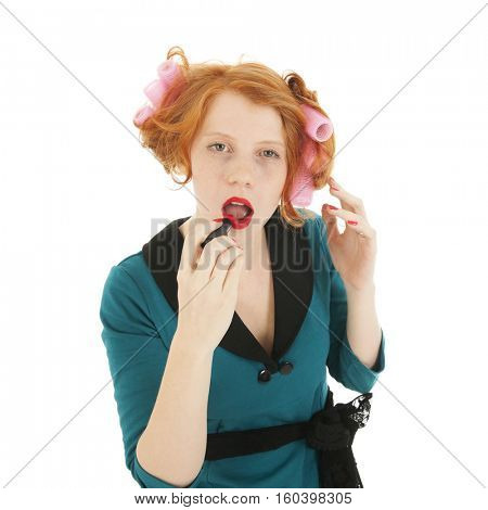 Young woman with curlers and lipstick isolated in studio